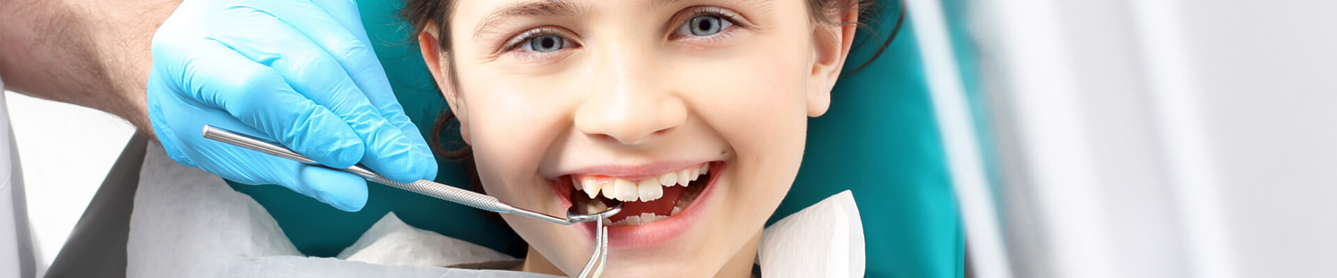 Child in the dental chair receiving dental treatment