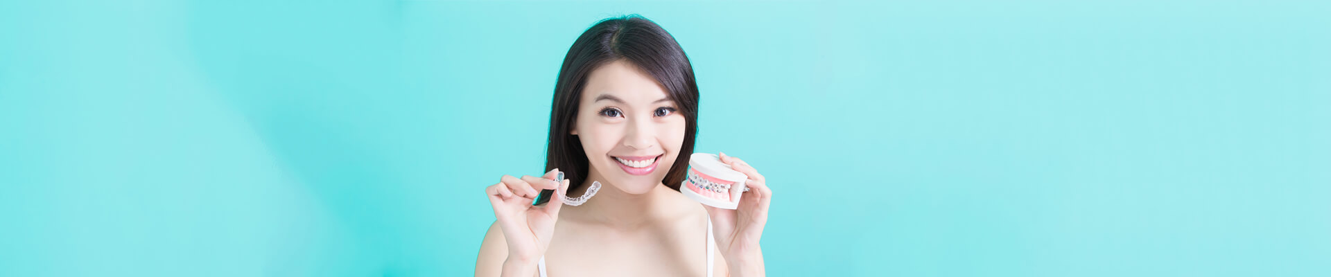 Happy female patient smiling showing invisalign braces