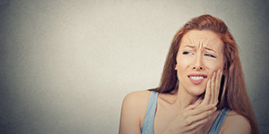 Dentist in Plano, TX educating patients on gum disease symptoms and treatments